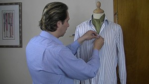 image of a classic day cravat being tied and positioned correctly on a tailors dummy. Learn to sew the day cravat with the help of the sewing guru. Easy to follow step by step sewing courses will teach you how to sew and create any garment and accessory of your choice #learntosew #learntotailor #howtosew #howtotailor.