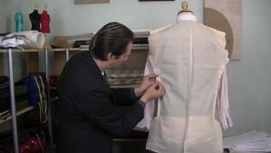 Bespoke tailor michael coates is making adjustments to a toile or slopper