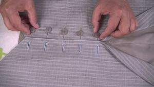 learn to sew a button on the front of a waistcoat. image showing the placement of buttons on the front of a waistcoat before they are sewn and attached #learntosew #howtosew.