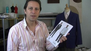 Your host at the sewng guru, michael coates is stood holding a commercial sewing pattern